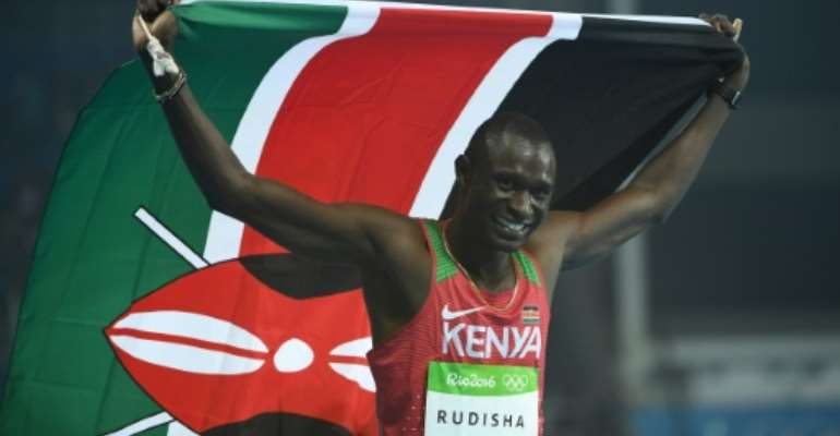 Kenya's David Rudisha, in a file image, celebrates his victory in the men's 800m final during the athletics event at the Rio 2016 Olympic Games at the Olympic Stadium in Rio de Janeiro.  By Johannes EISELE (AFP/File)