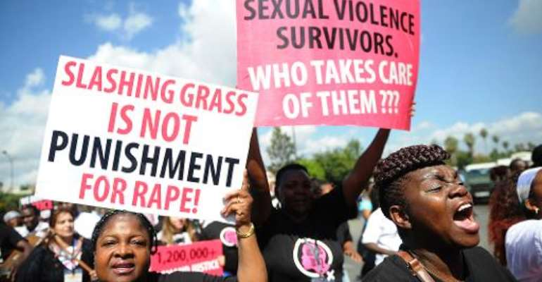 Kenyan protestors march on October 31, 2013 in Nairobi demanding justice after men accused of brutally gang raping a schoolgirl cut grass as punishment.  By Simon Maina (AFP/File)