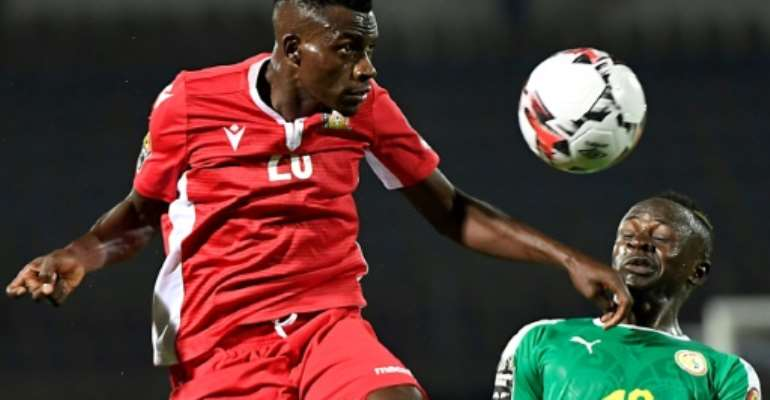 Kenya's midfielder Philemon Otieno (L) heads the ball next to Senegal's forward Sadio Mane.  By Khaled DESOUKI (AFP)