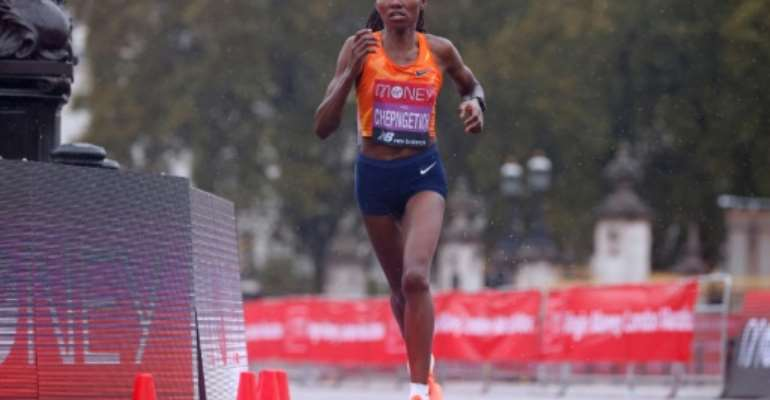 Kenya's Ruth Chepngetich sliced almost half a minute off the previous best mark of 1hr 4:31.  By JOHN SIBLEY (POOL/AFP)