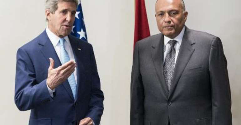 John Kerry (left) and Egyptian Foreign Minister Sameh Shoukri make statements to the press upon Kerry's arrival in Cairo June 22, 2014.  By Brendan Smialowski (pool/AFP)