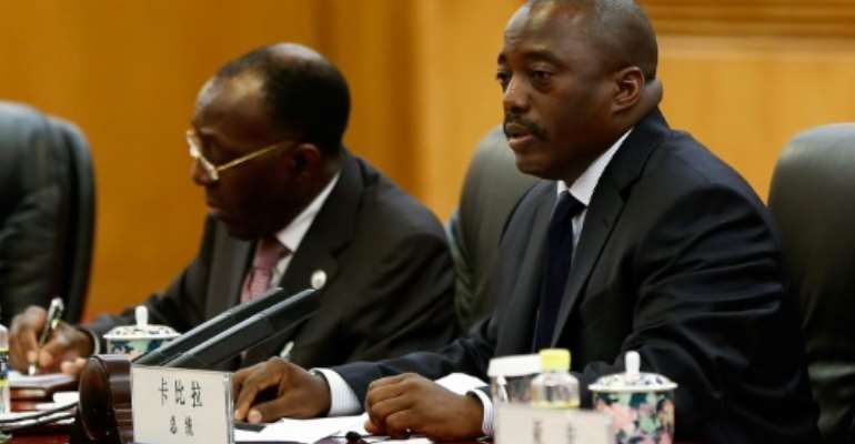 President Joseph Kabila (R), pictured here on September 4, 2015, has headed the country through two terms since 2001 and cannot constitutionally try for a third term.  By Linta Zhang (Pool/AFP/File)