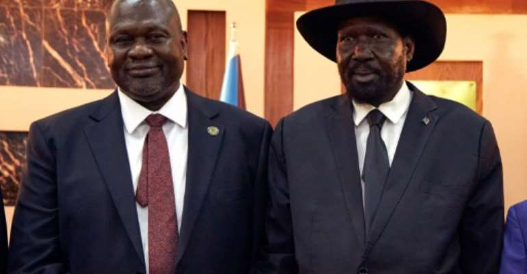 Kiir (R) and Machar have been locked in an uneasy coalition following the end of afive-year civil war.  By ALEX MCBRIDE (AFP/File)