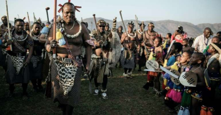 King Mswati III has 14 wives and more than 25 children.  By GIANLUIGI GUERCIA (AFP/File)