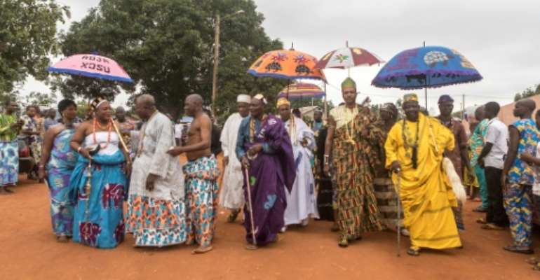 Kings from various districts of Abomey, Benin, arrive for the funeral of Dah Dedjalagni Agoli-Agbo, monarch of the former military kingdom of Dahomey on August 11, 2018.  By YANICK FOLLY (AFP/File)