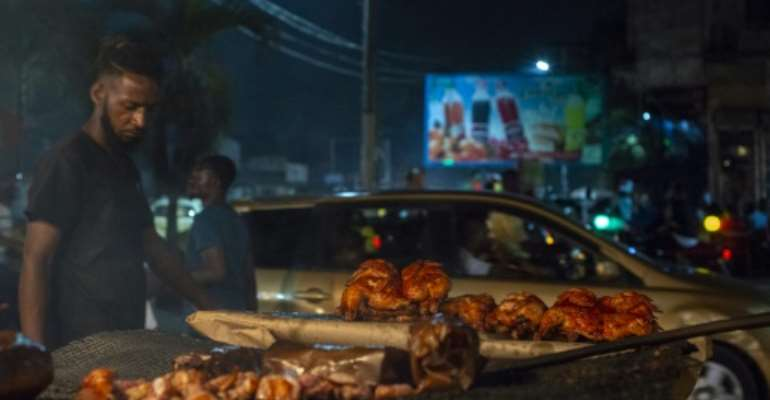 Kinshasa has been dependent on imported frozen chicken for years -- there isn't enough local produce to sustain this bustling, 12-million-strong city.  By ARSENE MPIANA (AFP)