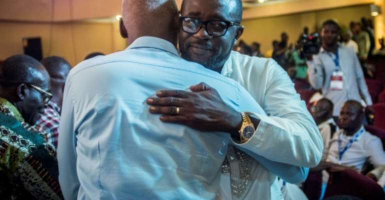 Kurt Okraku (R) was elected the new head of the Ghanaian FA after the body was rocked by a corruption scandal.  By CRISTINA ALDEHUELA (AFP)
