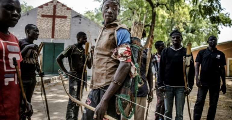 Land of tensions: Hunters armed with bows and arrows gathered in Dasso, central Nigeria, in February pledging to defend farmers in conflict with nomadic herdsmen.  By Luis TATO (AFP)