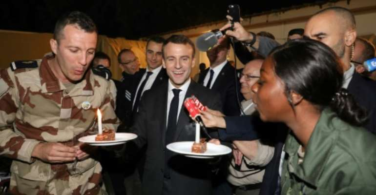 Last year French President Emmanuel Macron celebrated with French troops in Chad.  By Ludovic MARIN (AFP)