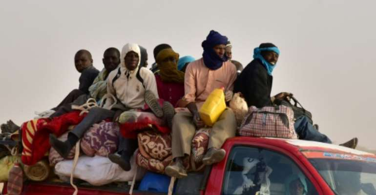 Last year, some 335,000 migrants were observed crossing northwards through Niger en route to Europe or to find work in Libya.  By ISSOUF SANOGO (AFP)