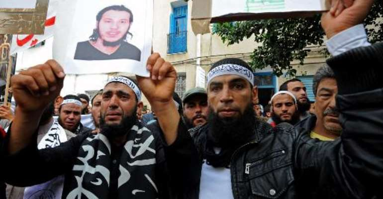 Tunisian Salafists rally in front of a court house in Tunis on November 6, 2012, to demand the release of people arrested in connection with the attack on the US embassy.  By Fethi Belaid (AFP/File)