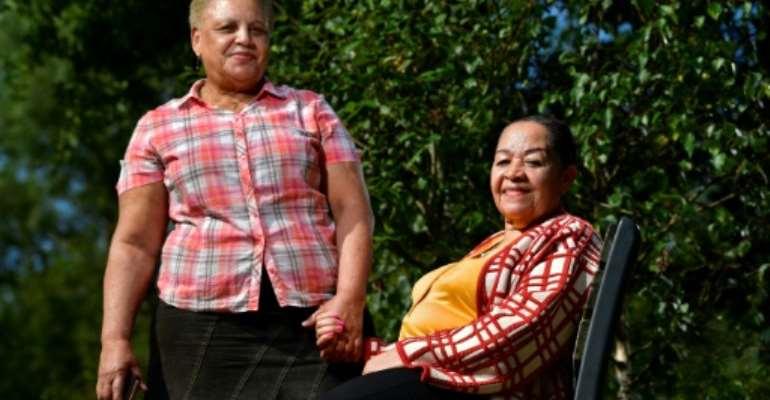 Lea Mujinga Tavares (R) and Simone Vandenbroeck are among the women suing Belgium.  By JOHN THYS (AFP)