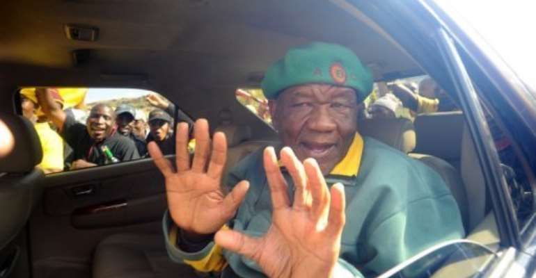 Thomas Thabane, leader of All Basotho Convention, greets supporters in Maseru on May 27.  By Alexander Joe (AFP/File)