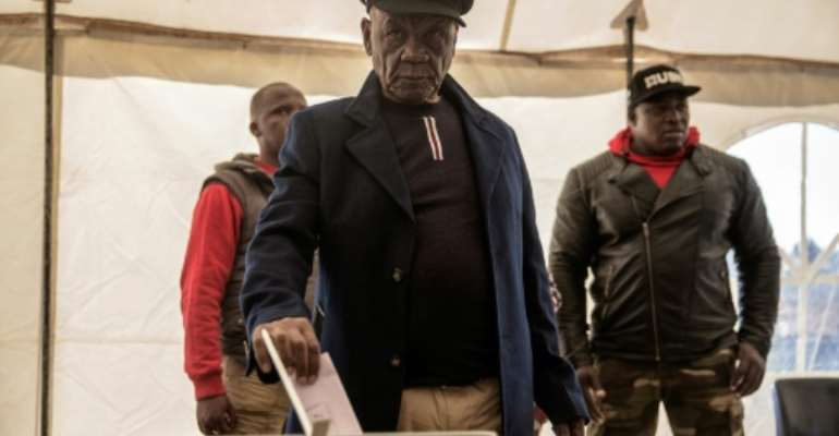 Lesotho Prime Minister Thomas Thabane (C) was summoned by police for questioning over alleged links to the 2017 murder of his estranged wife.  By GIANLUIGI GUERCIA (AFP/File)