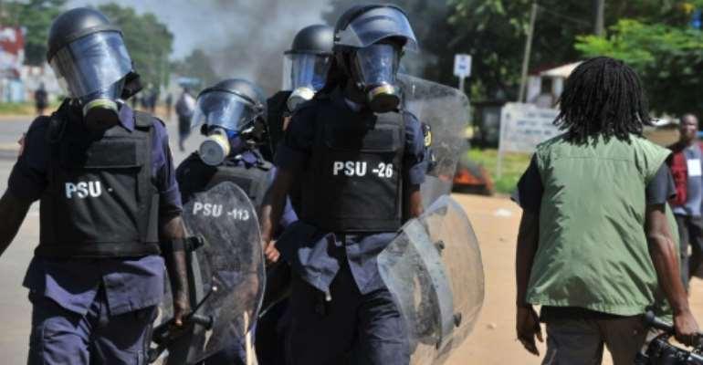 Liberian police walk in street in Monrovia on November 7, 2011.  By Issouf Sanogo (AFP/File)