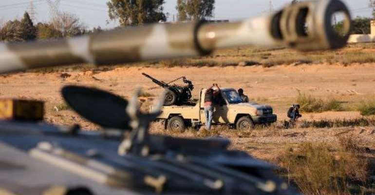 Members of the Tripoli Rebels Brigade militia patrol a main road in Tajura, 15 kms from the capital on November 16, 2013.  By Mahmud Turkia (AFP/File)