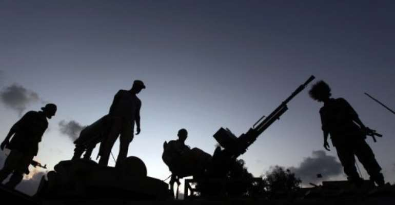 Libyan rebels guard an outpost on the outskirts of Sirte.  By Ahmad al-Rubaye (AFP/File)