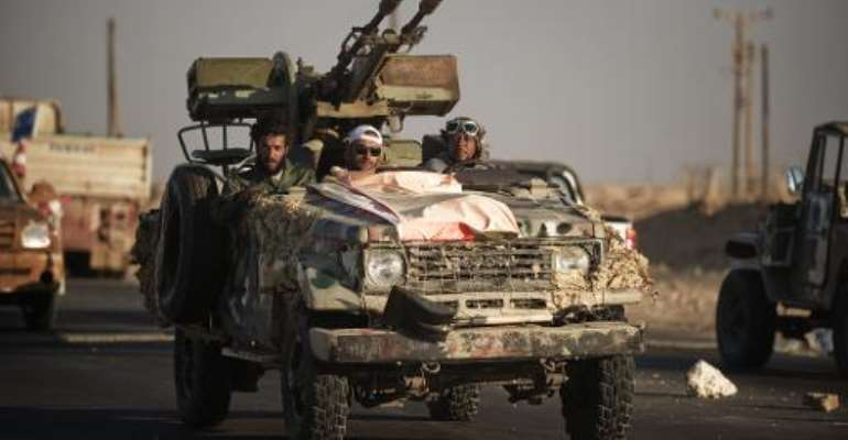 Libyan rebels head from Ras Lanuf to the Bin Jawad frontline on August 26, 2011.  By Gianluigi Guercia (AFP/File)