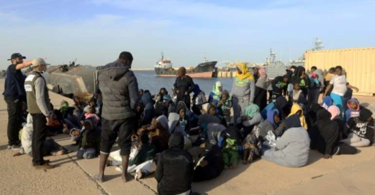 Libya has become a key transit country for African migrants seeking to reach Europe, including this group, rescued from the Mediterranean and taken to a naval base in Tripoli on January 7, 2018.  By MAHMUD TURKIA (AFP)