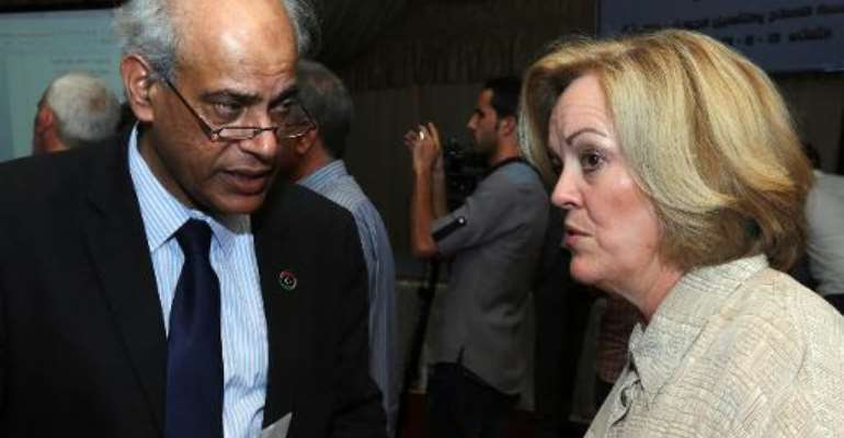Salah al-Maghani and Deborah Jones at the opening ceremony in Misrata on August 13, 2013 of the Al-Gauia Reform and Rehabilitation center.  By Mahmud Turkia (AFP/File)