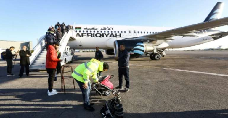 Libyan airline Afriqiyah Airways resumed flights from Tripoli's Mitiga airport after months of suspension on December 12.  By Mahmud TURKIA (AFP)
