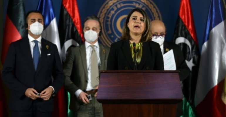 Libyan Foreign Minister Najla al-Mangoush speaks, as her counterparts (R to L) French Jean-Yves Le Drian, German Heiko Maas and Italian Luigi Di Maio listen, during a press conference in Libya's capital Tripoli, on March 25, 2021.  By Mahmud TURKIA (AFP)