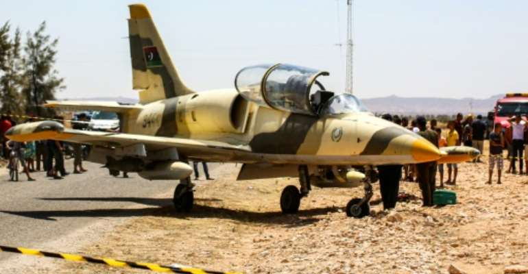 Libyan L-39 Albatros warplane belonging to forces of strongman Khalifa Haftar, after it made an emergency landing last month in southeast Tunisia.  By Fathi NASRI (AFP)