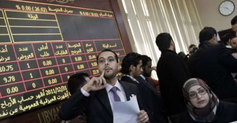 Brokers work during the official reopening of the Libyan stock market in Tripoli Thursday.  By Gianluigi Guercia (AFP)