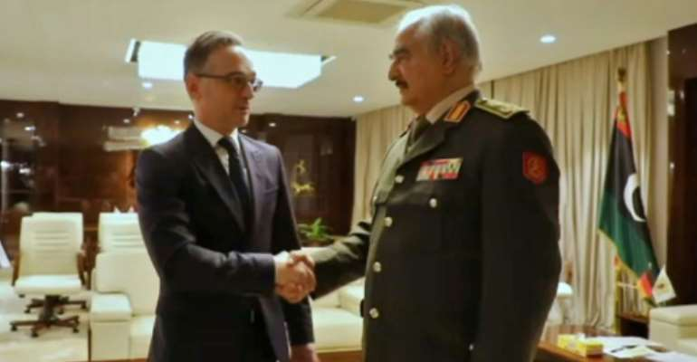Libyan strongman Khalifa Haftar greets German Foreign Minister Heiko Maas in his eastern stronghold Benghazi.  By - (LNA War Information Division/AFP)
