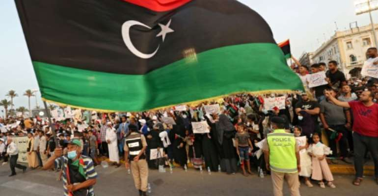 Libyans attend a rally in the capital Tripoli to denounce parliament's no-confidence vote against the unity government ahead of planned December elections.  By Mahmud TURKIA (AFP)
