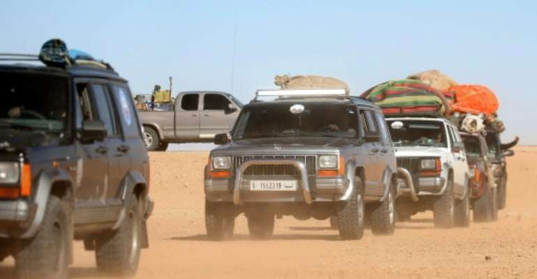 Libyans take part in a 4x4 tourism trip through the desert.  By Mahmud TURKIA (AFP)