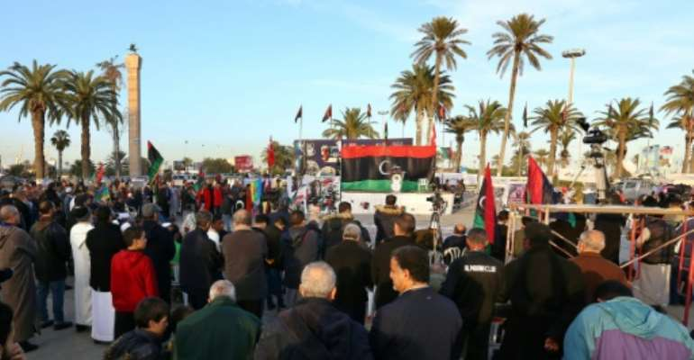 Libyans take part in a demonstration against eastern strongman Khalifa Haftar -- who is backed by France, Russia and others -- and in support of the UN-recognised Government of National Accord (GNA), at Martyrs' Square in the GNA-held capital Tripoli.  By - (AFP/File)