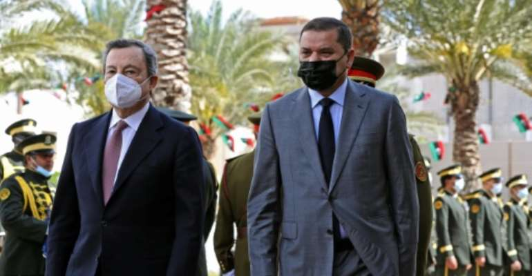 Libya's interim Prime Minister Abdul Hamid Dbeibah (R) receives Italian Prime Minister Mario Draghi at the premier's office in the Libyan capital Tripoli.  By Mahmud Turkia (AFP)