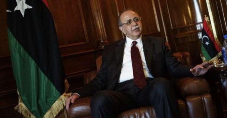 Abdel Rahim al-Kib said Libya was heading towards a knowledge and market-based economy.  By Gianluigi Guercia (AFP)
