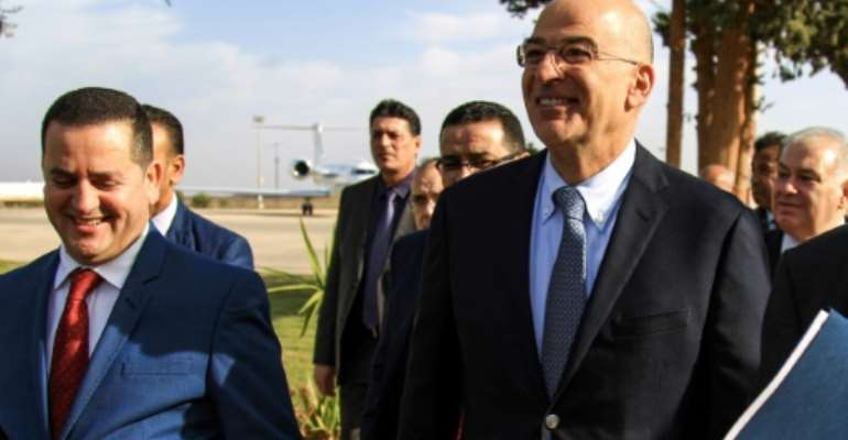 Libya's parallel eastern government foreign minister Abdulhadi Lahweej met Greek Foreign Minister Nikos Dendias in Benghazi on Sunday.  By Abdullah DOMA (AFP)
