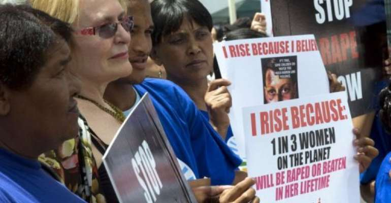 Western Cape Province Premier Helen Zille (2nd L) joins a protest agaisnt rape on February 11, 2013.  By Rodger Bosch (AFP)
