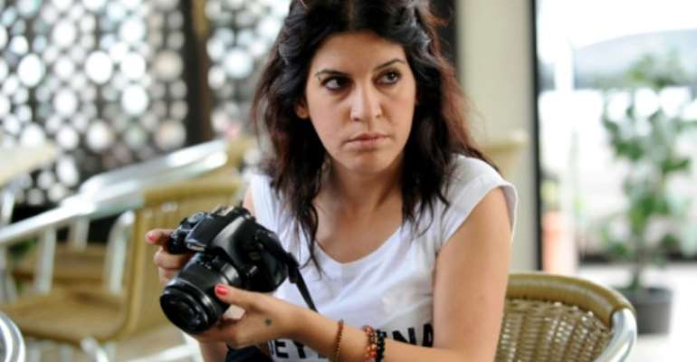 Lina Ben Mhenni, an activist blogger who was prominent during the popular uprising that led to the downfall of president Zine El Abidine Ben Ali, has died at the age of 36.  By Fethi Belaid, Fethi Belaid (AFP/File)