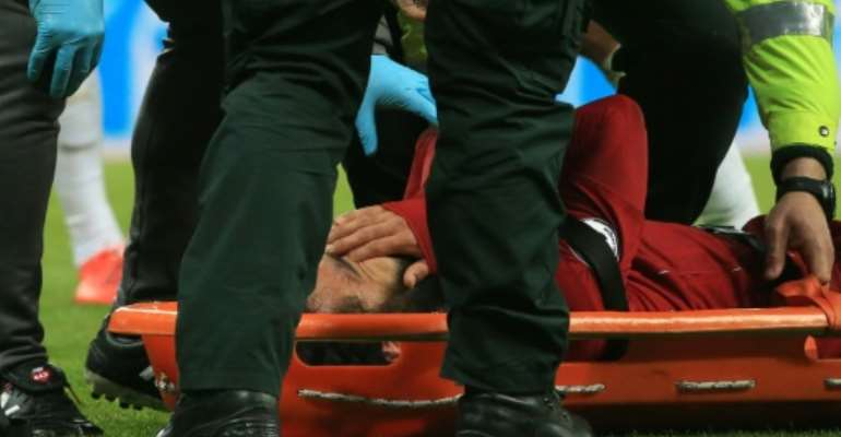 Liverpool manager Jurgen Klopp will have a nervous wait to see whether leading scorer Mohamed Salah suffered concussion in the 3-2 win over Newcastle which kept their title hopes alive.  By Lindsey PARNABY (AFP)