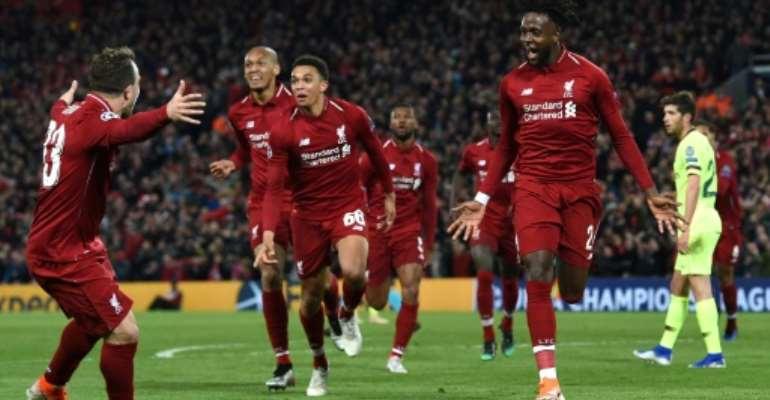 Liverpool's Divock Origi (R) celebrates after scoring against Barcelona.  By Paul ELLIS (AFP/File)