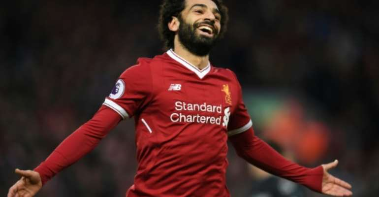 Liverpool's Egyptian midfielder Mohamed Salah celebrates scoring the team's first goal during the English Premier League football match against Leicester December 30, 2017.  By Paul ELLIS (AFP/File)