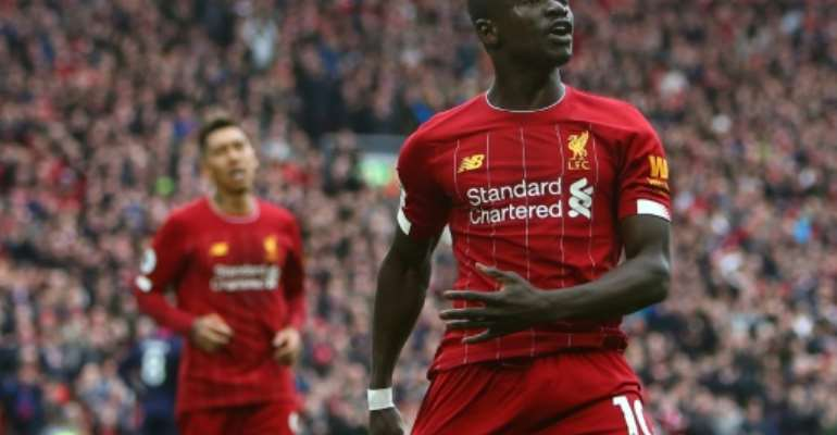 Liverpool's Senegalese striker Sadio Mane has donated $50000 US dollars to the Coronavirus fight in gis country.  By GEOFF CADDICK (AFP/File)