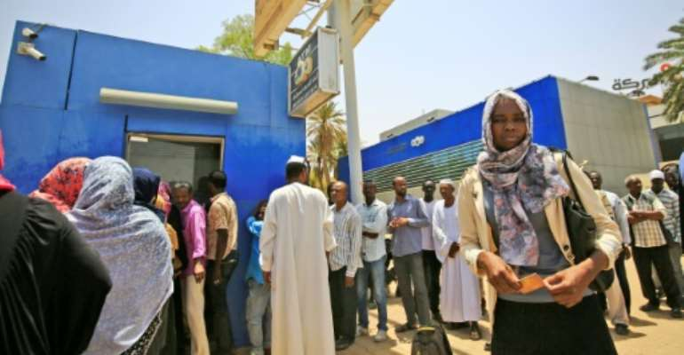 Long waits at the ATM for days and still no cash -- a chronic liquidity crisis is still gripping Sudan a month after its veteran strongman's ouster.  By ASHRAF SHAZLY (AFP)