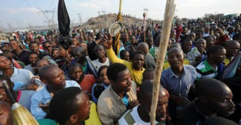People gather in Marikana on August 23 after attending a memorial service for the 44 individuals killed.  By  (AFP/File)