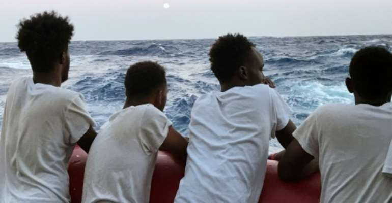 Looking for a safe harbour: Migrants onboard the Ocean Viking rescue ship.  By Anne CHAON (AFP/File)