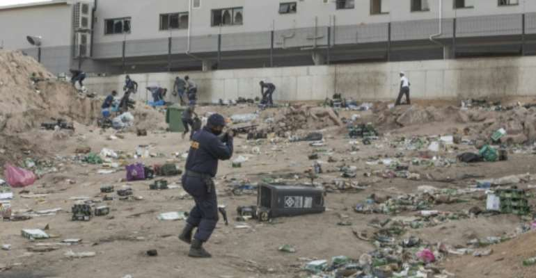 Looters ransacked shopping centres and unidentified groups torched key industrial infrastructure and blocked trade routes during the unrest.  By GUILLEM SARTORIO (AFP/File)