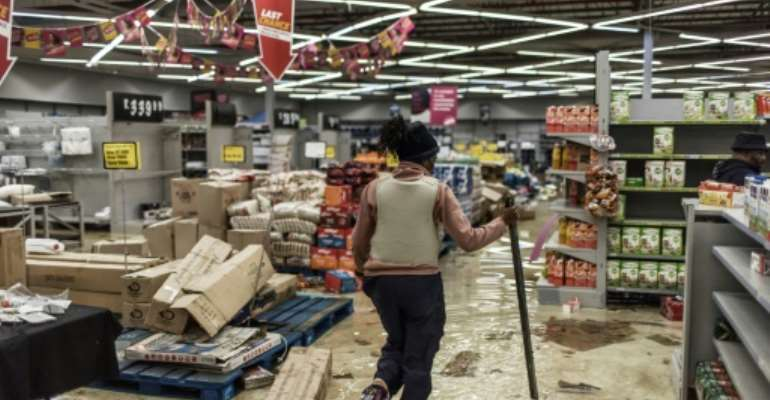 Looting and rioting has erupted in Zuma's home region KwaZulu-Natal as well as Gauteng province, claiming more than 200 lives.  By MARCO LONGARI (AFP)