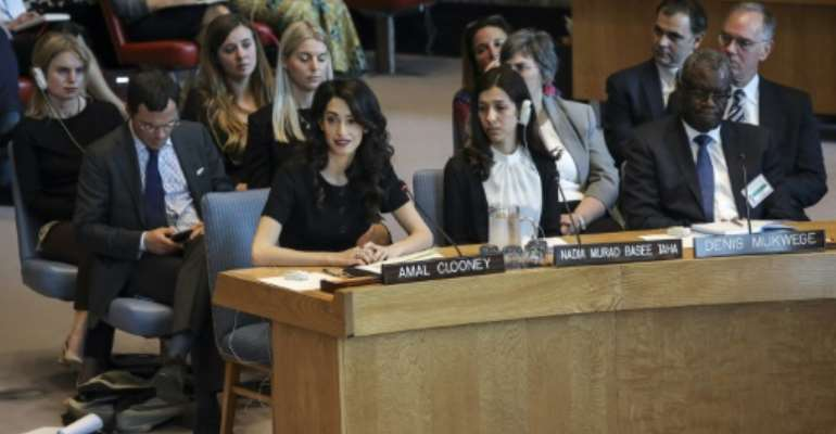 (L-R) Human rights lawyer Amal Clooney joins 2018 Nobel Peace Prize laureates Nadia Murad and Denis Mukwege in urging the United Nations to act against sexual violence in conflicts.  By Drew Angerer (GETTY/AFP)
