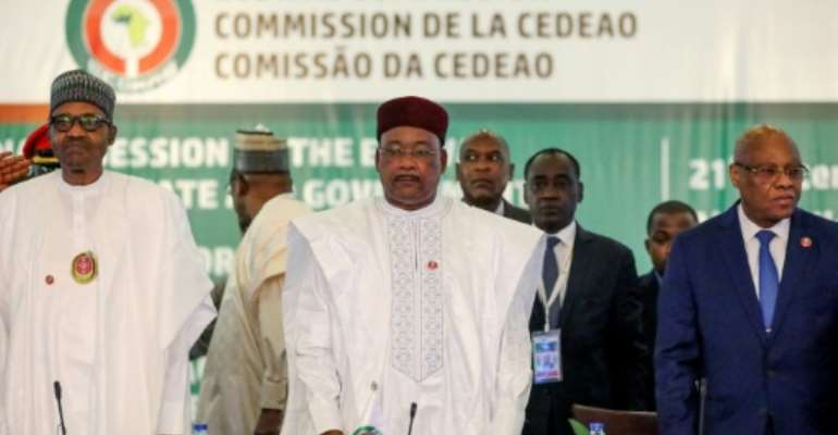 L-R: Nigeria President Muhammadu Buhari, Chairman, ECOWAS, Mahamadou Issoufou, and President of Ecowas Commission, Jean-Claude Kassi Brou attend the fifty-sixth ordinary session of the Economic Community of West African States in Abuja.  By Kola SULAIMON (AFP)