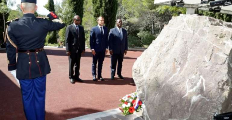 (LtoR) The leaders of Guinea, France and Ivory Coast attend a ceremony marking the 75th anniversary of the Allied landings in Provence during World War II on Thursday.  By ERIC GAILLARD (POOL/AFP)