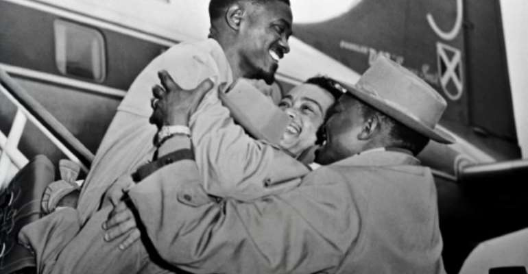 Lumumba, the hero of Belgian Congo's independence, is welcomed at Brussels airport in January 1960. Within a year, Lumumba would be dead..  By  (AFP)
